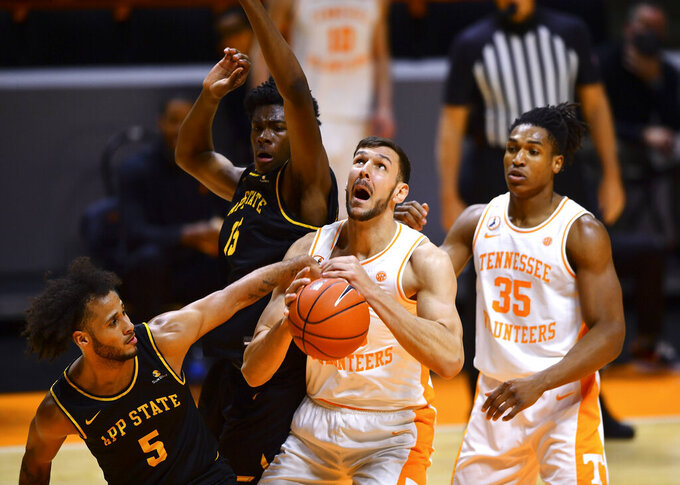 Tennessee forward Uros Plavsic (33) looks for the basket during an NCAA college basketball game against Appalachian State in Knoxville, Tenn., on Tuesday, Dec. 15, 2020.  (Brianna Paciorka/Knoxville News Sentinel via AP)