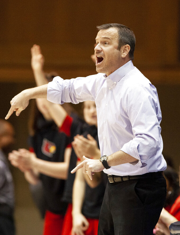 Louisville head coach Jeff Walz directs his team during the first half of an NCAA college basketball game against Duke in Durham, N.C., Sunday, Jan. 6, 2019. (AP Photo/Ben McKeown)