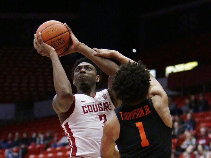 Washington State forward Robert Franks Jr., left, shoots over Oregon State guard Stephen Thompson Jr. during the first half of an NCAA college basketball game in Pullman, Wash., Saturday, March 9, 2019. (AP Photo/Young Kwak)