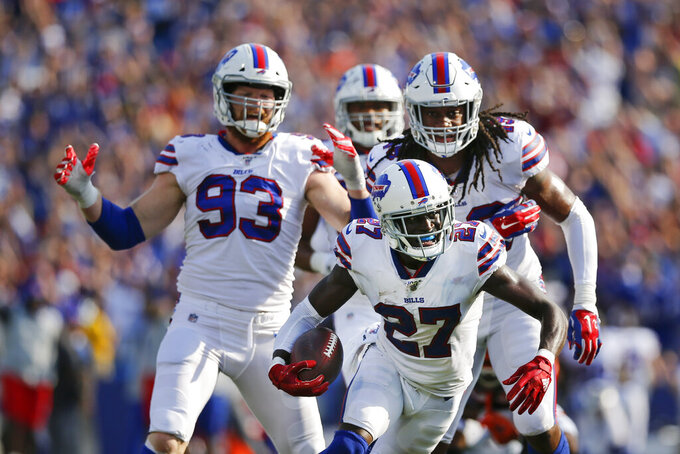Buffalo Bills cornerback Tre'Davious White (27) celebrates after intercepting a pass during the second half of an NFL football game against the Cincinnati Bengals, Sunday, Sept. 22, 2019, in Orchard Park, N.Y. The Bills won 21-17. (AP Photo/John Munson)
