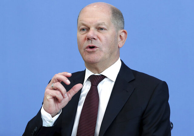 German Finance Minister Olaf Scholz addresses the media during a press conference in Berlin, Germany, Thursday, May 14, 2020. (AP Photo/Michael Sohn, pool)