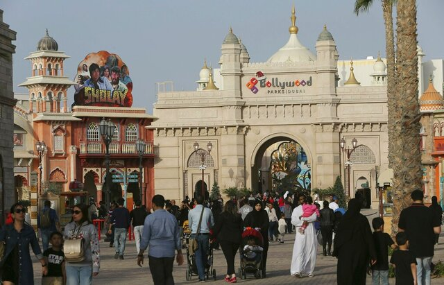 FILE - In this Dec. 18, 2016 file photo, people visit the Bollywood theme park at Dubai Parks & Resorts in Dubai, United Arab Emirates. The owner of Dubai's struggling theme park operator is planning to sell itself to its majority shareholder, the company said in documents filed Sunday, Dec. 20, 2020, with the Dubai Financial Market, capping years of plummeting income and stocks. (AP Photo/Kamran Jebreili, File)