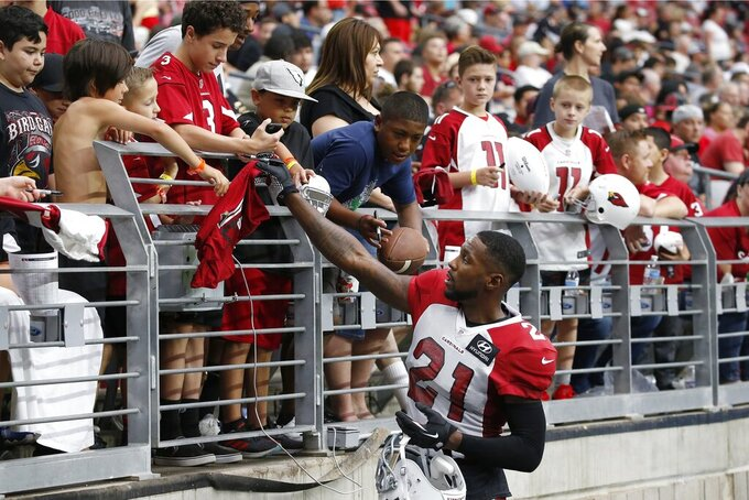 Arizona Cardinals cornerback Patrick Peterson signs autographs during a break in the team's NFL football training camp Wednesday, July 31, 2019, in Glendale, Ariz. (AP Photo/Ross D. Franklin)