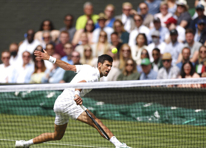 Serbia's Novak Djokovic plays a return to Italy's Matteo Berrettini during the men's singles final on day thirteen of the Wimbledon Tennis Championships in London, Sunday, July 11, 2021. (Steve Paston/Pool Via AP)
