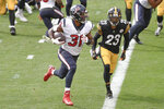 Houston Texans running back David Johnson (31) gets past Pittsburgh Steelers cornerback Joe Haden (23) to score a touchdown during the first half of an NFL football game, Sunday, Sept. 27, 2020, in Pittsburgh. (AP Photo/Don Wright)