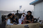 Taliban fighters sit in a pickup truck at the airport in Kabul, Afghanistan, Thursday, Sept. 9, 2021. Some 200 foreigners, including Americans, flew out of Afghanistan on an international commercial flight from Kabul airport on Thursday, the first such large-scale departure since U.S and foreign forces concluded their frantic withdrawal at the end of last month. (AP Photo/Bernat Armangue)