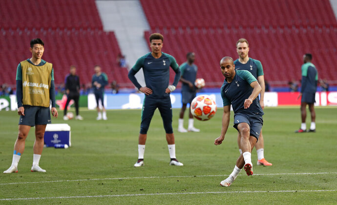 Tottenham midfielder Lucas Moura kicks the ball during a training session at the Wanda Metropolitano stadium in Madrid, Friday May 31, 2019. English Premier League teams Liverpool and Tottenham Hotspur are preparing for the Champions League final which takes place in Madrid on Saturday night. (AP Photo/Manu Fernandez)