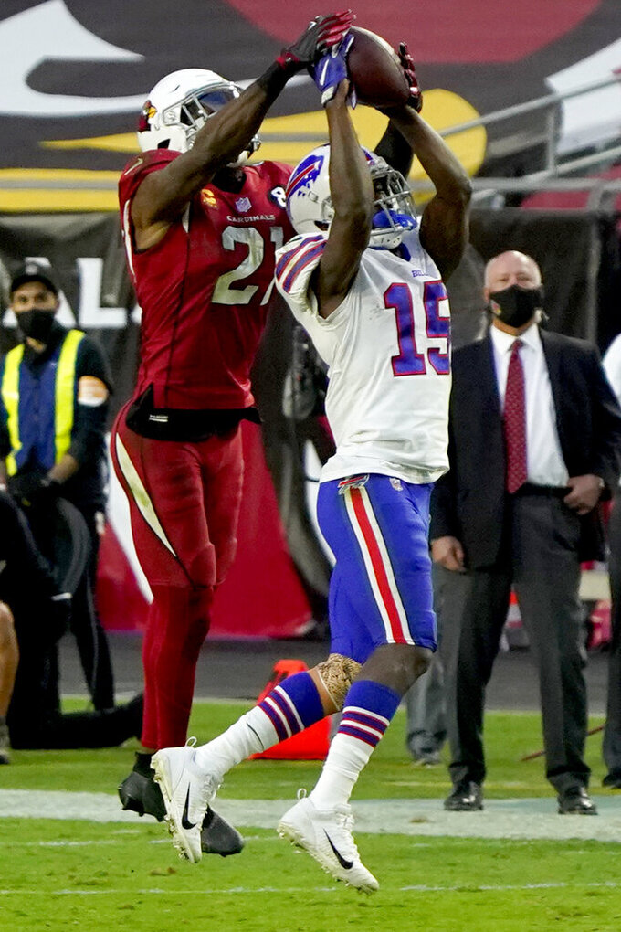 Buffalo Bills wide receiver John Brown (15) pulls in a pass as Arizona Cardinals cornerback Patrick Peterson (21) fends during the second half of an NFL football game, Sunday, Nov. 15, 2020, in Glendale, Ariz. (AP Photo/Rick Scuteri)