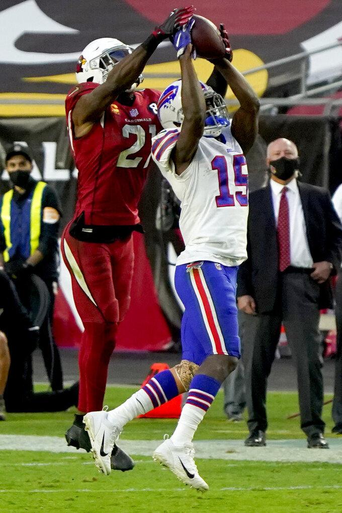 Buffalo Bills wide receiver John Brown (15) pulls in a pass as Arizona Cardinals cornerback Patrick Peterson (21) fends during the second half of an NFL football game, Sunday, Nov. 15, 2020, in Glendale, Ariz. (AP Photo/Rick Scuteri)