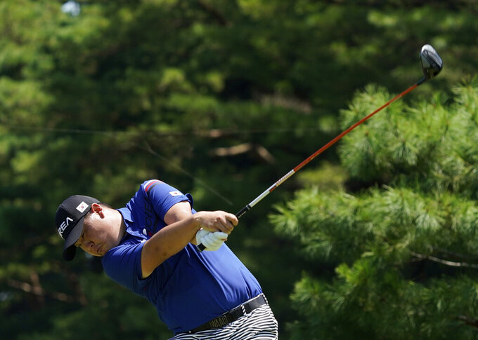 Korea's Si Woo Kim plays a tee shot from the 12th hole during a practice round of the men's golf event at the 2020 Summer Olympics, Tuesday, July 27, 2021, at the Kasumigaseki Country Club in Kawagoe, Japan, (AP Photo/Matt York)