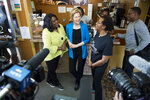 Rep Terri Sewell, left, and Democratic presidential candidate Sen. Elizabeth Warren, D-Mass., talk with Coffee Shoppe owner Jackie Smith in Selma, Ala., on Tuesday, March 19, 2019. (Jake Crandall/The Montgomery Advertiser via AP)