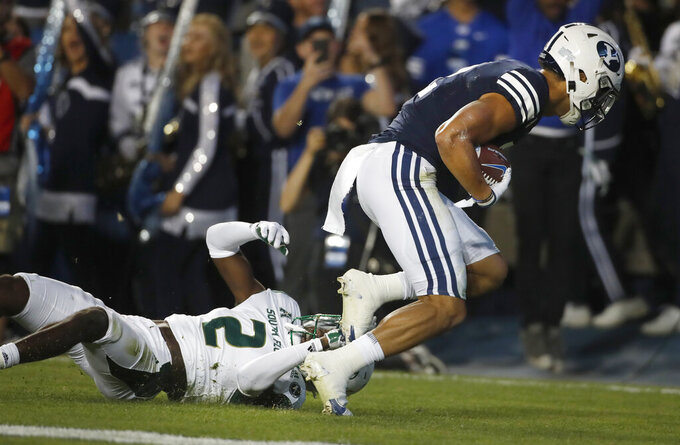 BYU wide receiver Neil Pau'u (R) catches a touchdown pass over South Florida defensive back TJ Robinson (2) in the first half of an NCAA college football game Saturday, Sept. 25, 2021, in Provo, Utah. (AP Photo/George Frey)