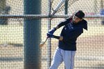 Cleveland Indians' Billy Hamilton connects with a baseball in batting practice during a spring training baseball practice Monday, Feb. 22, 2021, in Goodyear, Ariz. (AP Photo/Ross D. Franklin)