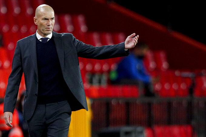 Real Madrid's head coach Zinedine Zidane gestures during the Spanish La Liga soccer match between Granada and Real Madrid at Los Carmenes stadium in Granada, Spain, Thursday, May 13, 2021. (AP Photo/Fermin Rodriguez)