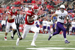 Rutgers running back Isaih Pacheco, center, runs for a touchdown as Northwestern linebacker Paddy Fisher, right, tries to stop him during the first half of an NCAA college football game, Saturday, Oct. 20, 2018, in Piscataway, N.J. (AP Photo/Julio Cortez)