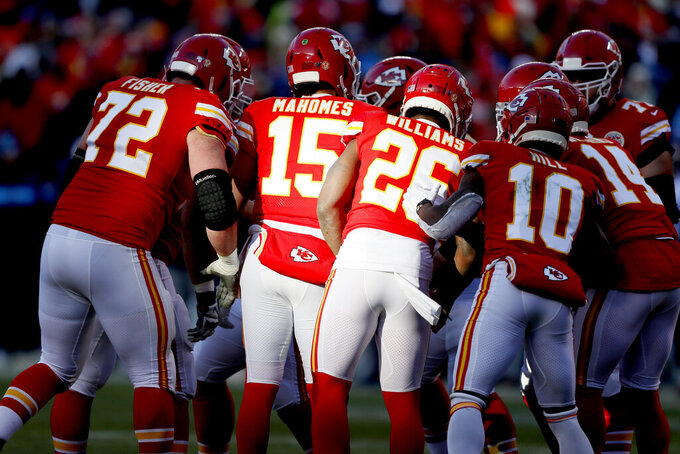 Kansas City Chiefs' Patrick Mahomes huddles with teammates during the first half of the NFL AFC Championship football game against the Tennessee Titans Sunday, Jan. 19, 2020, in Kansas City, MO. (AP Photo/Charlie Neibergall)