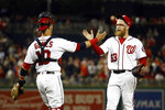 Washington Nationals catcher Yan Gomes, left, and relief pitcher Sean Doolittle celebrate after closing out a baseball game against the New York Mets, Wednesday, May 15, 2019, in Washington. Washington won 5-1. (AP Photo/Patrick Semansky)