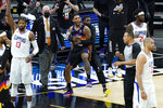 Phoenix Suns' Cameron Payne, center left, celebrates with teammates during the second half of Game 2 of the NBA basketball Western Conference Finals against the Los Angeles Clippers, Tuesday, June 22, 2021, in Phoenix. (AP Photo/Matt York)