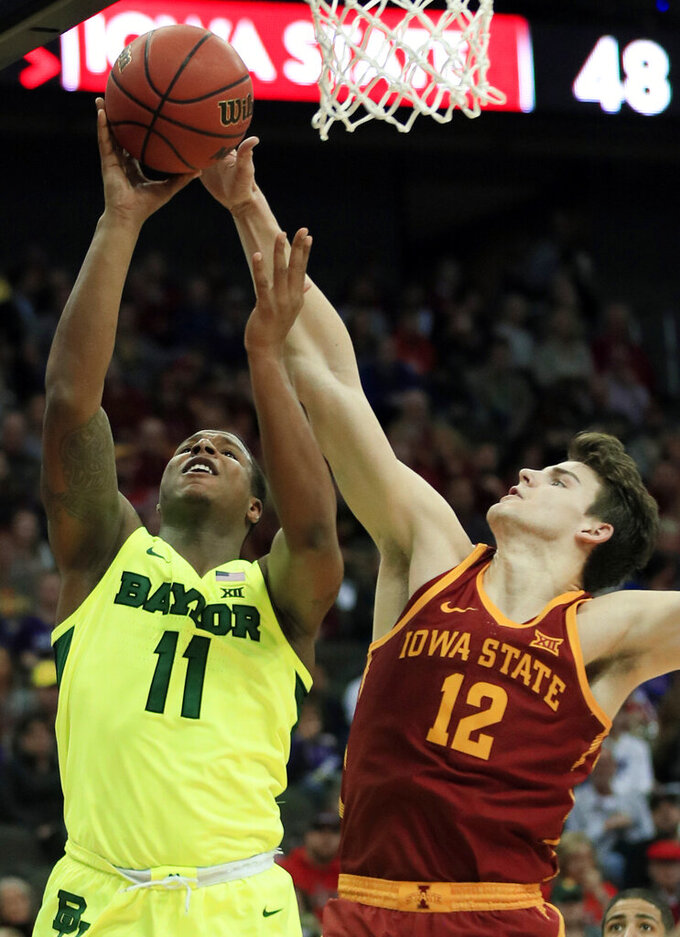 Baylor guard Mark Vital (11) shoots as Iowa State forward Michael Jacobson (12) defends during the second half of an NCAA college basketball game in the quarterfinals of the Big 12 conference tournament in Kansas City, Mo., Thursday, March 14, 2019. Iowa State defeated Baylor 83-66. (AP Photo/Orlin Wagner)