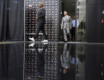Chauncey Billups, left, and general manager Neil Olshey walk to the podium before Billups is announced as the head coach of the Portland Trail Blazers at the team's practice facility in Tualatin, Ore., Tuesday, June 29, 2021. (AP Photo/Craig Mitchelldyer)