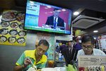 A TV screens is broadcasting Chinese President Xi Jinping during an event to commemorate the 40th anniversary of the establishment of the Shenzhen Special Economic Zone in Shenzhen in southern China's Guangdogn Province at a restaurant in Hong Kong, Wednesday, Oct. 14, 2020. Xi promised Wednesday new steps to back development of China's biggest tech center, Shenzhen, amid a feud with Washington that has disrupted access to U.S. technology and is fueling ambitions to create Chinese providers. (AP Photo/Vincent Yu)