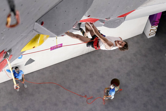 Adam Ondra, of the Czech Republic, competes during the lead portion of the men's sport climbing final at the 2020 Summer Olympics, Thursday, Aug. 5, 2021, in Tokyo, Japan. (AP Photo/Jeff Roberson, POOL)
