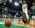 Boston Celtics' Grant Williams (12) and Milwaukee Bucks' Robin Lopez watch as a loose ball goes out of bounds during the first quarter of an NBA basketball game Wednesday, Oct. 30, 2019, in Boston. (AP Photo/Winslow Townson)