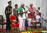 Karnataka state governor Vajubhai Vala, front right, administers oath to Bharatiya Janata Party (BJP) leader B. S. Yeddyurappa, in green shawl, as Chief Minister of the state in Bangalore, India, Thursday, May 17, 2018. The elections in India's southern state of Karnataka were held on last Saturday. (AP Photo/Aijaz Rahi)