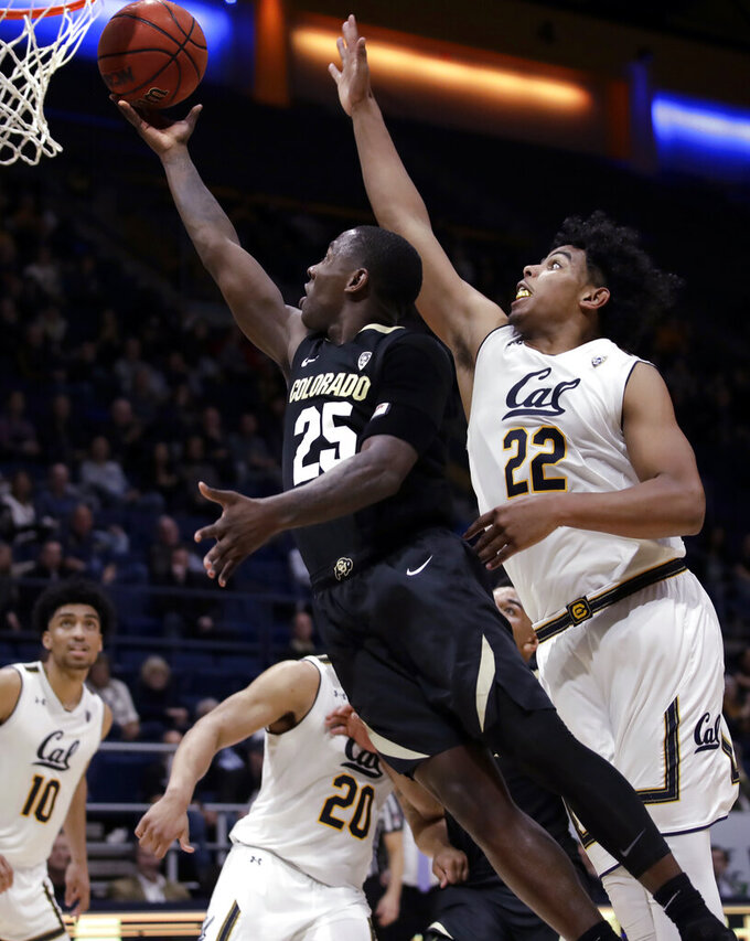Colorado's McKinley Wright IV, left, lays up a shot past California's Andre Kelly (22) during the second half of an NCAA college basketball game Thursday, Jan. 24, 2019, in Berkeley, Calif. (AP Photo/Ben Margot)