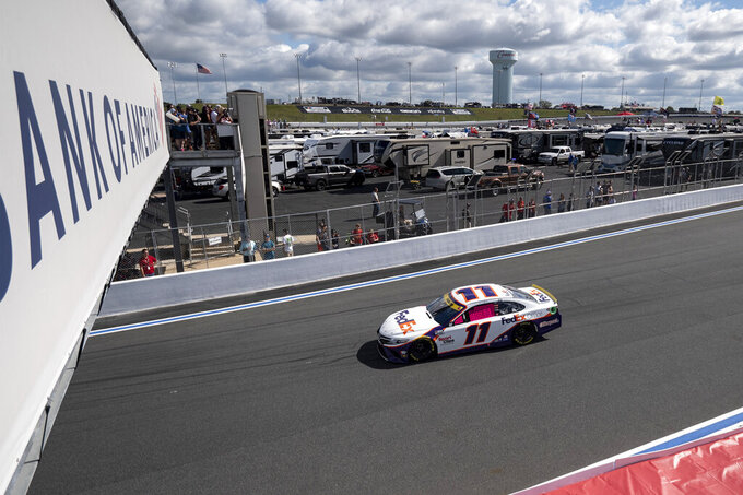 Denny Hamlin (11) drives during the NASCAR Cup Series auto racing race at the Charlotte Motor Speedway Sunday, Oct. 10, 2021, in Concord, N.C. (AP Photo/Matt Kelley)