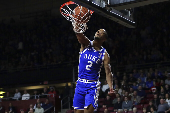 Duke guard Cassius Stanley (2) slams a dunk during the first half of an NCAA college basketball game against Boston College in Boston, Tuesday, Feb. 4, 2020. (AP Photo/Charles Krupa)