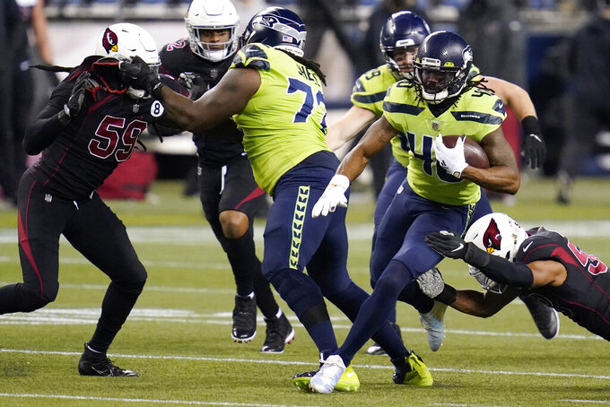 Seattle Seahawks running back Bo Scarbrough (40) rushes against the Arizona Cardinals during the first half of an NFL football game, Thursday, Nov. 19, 2020, in Seattle. (AP Photo/Elaine Thompson)