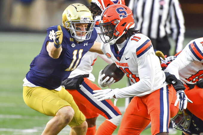 Syracuse defensive back Ja'Had Carter (11) runs after an interception as Notre Dame wide receiver Ben Skowronek (11) attempts to tackle in the second half of an NCAA college football game Saturday, Dec. 5, 2020, in South Bend, Ind. (Matt Cashore/Pool Photo via AP)