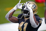 New Orleans Saints running back Alvin Kamara (41) reacts after his touchdown carry in the second half of an NFL football game against the Kansas City Chiefs in New Orleans, Sunday, Dec. 20, 2020. (AP Photo/Butch Dill)
