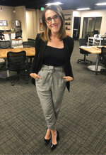 """This photo provided by Maggie Vespa, a weekend news anchor and TV reporter at NBC affiliate KGW-TV in Portland, Oregon, wearing one of five high-waisted pants that she wore for her five news casts over the weekend. Vespa wore the pants after a male viewer told her to """"dress like a normal woman"""" in a message sent to her Facebook work account. Vespa also delivered an on-air commentary about the remarks on Sunday's late-night news with the support of her managers. She wanted to draw attention to the pressure that women who work in the public eye face on a daily basis. (Maggie Vespa via AP)"""