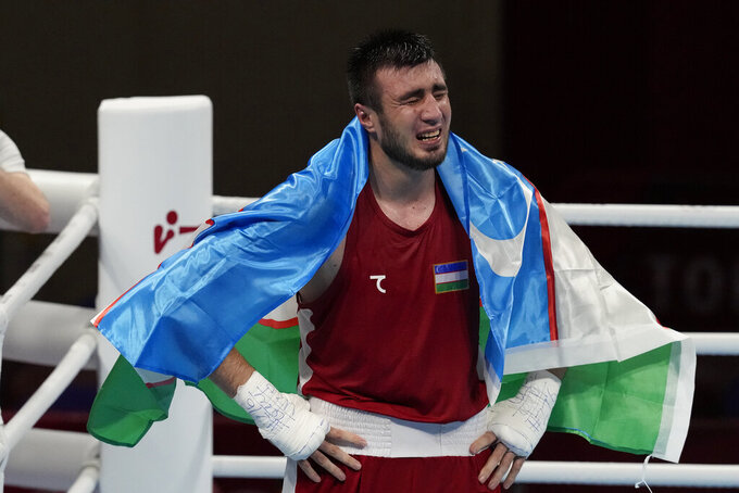 Uzbekistan's Bakhodir Jalalov, after his bout with Richard Torrez Jr., from the United States in their men's super heavyweight over 91-kg boxing gold medal match at the 2020 Summer Olympics, Sunday, Aug. 8, 2021, in Tokyo, Japan. (AP Photo/Themba Hadebe)