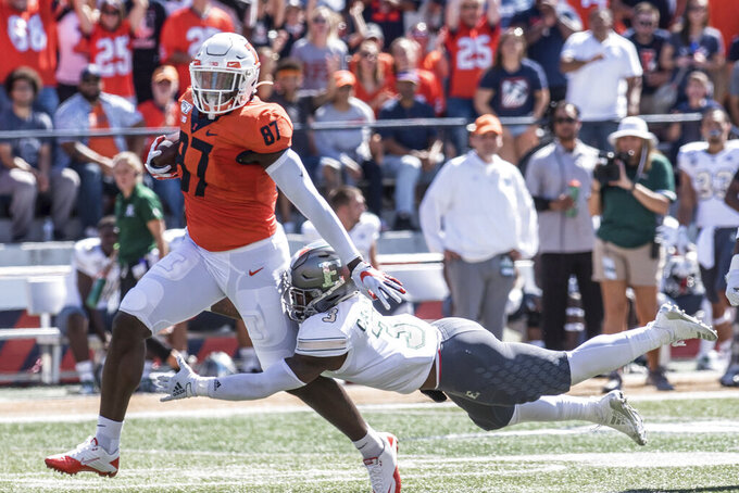 Illinois tight end Daniel Barker (87) runs the ball after making a catch as Eastern Michigan's Vince Calhoun (3) attempts the tackle n the first half of a NCAA college football game between Illinois and Eastern Michigan, Saturday, Sept.14, 2019, in Champaign, Ill. (AP Photo/Holly Hart)