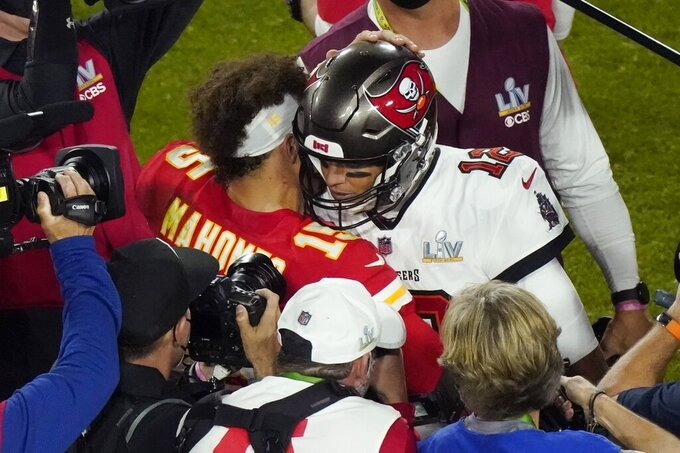 Kansas City Chiefs quarterback Patrick Mahomes (15) and Tampa Bay Buccaneers quarterback Tom Brady (12) greet following the NFL Super Bowl 55 football game Sunday, Feb. 7, 2021, in Tampa, Fla. Tampa Bay won 31-9. (AP Photo/Charlie Riedel)