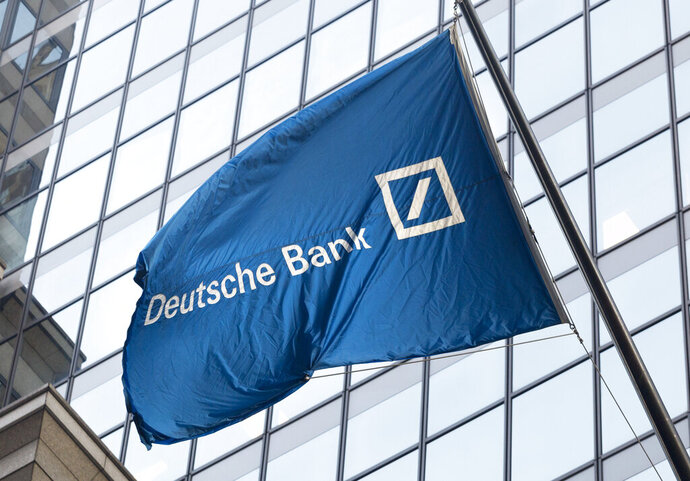 FILE - In this Oct. 7, 2016, file photo a flag for Deutsche Bank flies outside the German bank's New York offices on Wall Street. Deutsche Bank revealed in court papers on Tuesday, Aug. 27, 2019, that it has tax records Congress is seeking in its investigation into President Trump's finances. (AP Photo/Mark Lennihan, File)