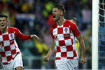 Croatia's Bruno Petkovic celebrates after scoring his side's second goal during the Euro 2020 group E qualifying soccer match between Croatia and Slovakia at the Rujevica stadium in Rijeka, Croatia, Saturday, Nov. 16, 2019. (AP Photo/Daniel Kasap)