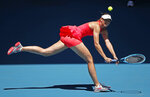 Russia's Maria Sharapova makes a backhand return to Croatia's Donna Vekic during their first round singles match at the Australian Open tennis championship in Melbourne, Australia, Tuesday, Jan. 21, 2020. (AP Photo/Lee Jin-man)