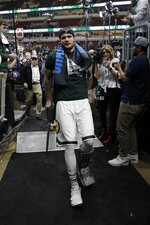 Michigan State's Kyle Ahrens walks off with crutches after defeating Michigan 65-60 in an NCAA college basketball championship game in the Big Ten Conference tournament, Sunday, March 17, 2019, in Chicago. (AP Photo/Nam Y. Huh)