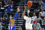 Utah State forward Alphonso Anderson (10) shoots as BYU forward Yoeli Childs (23) defends in the first half during an NCAA college basketball game Saturday, Dec. 14, 2019, in Salt Lake City. (AP Photo/Rick Bowmer)