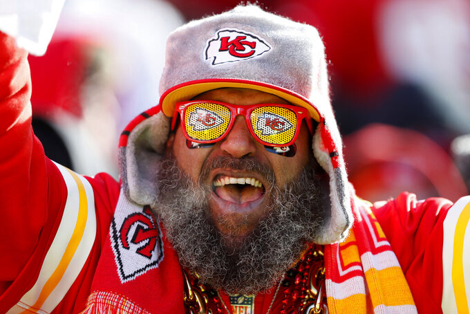 A Kansas City Chiefs fan cheers during the first half of the NFL AFC Championship football game against the Tennessee Titans Sunday, Jan. 19, 2020, in Kansas City, MO. (AP Photo/Charlie Neibergall)