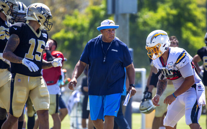 FILE - In this Thursday, Aug. 15, 2019 file photo, Los Angeles Chargers special teams coach George Stewart watches players during the NFL football team's joint practice with the New Orleans Saints in Costa Mesa, Calif. The Los Angeles Chargers have demoted special teams coordinator George Stewart, Wednesday, Nov. 25, 2020. The move comes after a series of breakdowns on special teams nearly cost the Chargers (3-7) against the New York Jets on Sunday. (Mark Rightmire/The Orange County Register via AP, File)