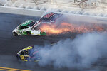 Jacob Heafner (77), Dave Mader III (63) and Andy Seuss (02) wreck in Turn 1 during the ARCA series auto race at Daytona International Speedway, Saturday, Feb. 8, 2020, in Daytona Beach, Fla. (AP Photo/David Graham)