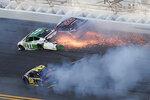 Jacob Heafner (77), Dave Mader III (63) and Andy Seuss (02) wreck in Turn 1 during the ARCA series auto race at Daytona International Speedway, Saturday, Feb. 8, 2020, in Daytona Beach, Fla. (AP Photo/David Graham)