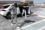 Mercedes driver Lewis Hamilton of Britain arrives to the paddock ahead of the first free practice at the Yas Marina racetrack in Abu Dhabi, United Arab Emirates, Friday, Dec. 11, 2020. The Emirates Formula One Grand Prix will take place on Sunday. (Hamad Mohammed, Pool via AP)