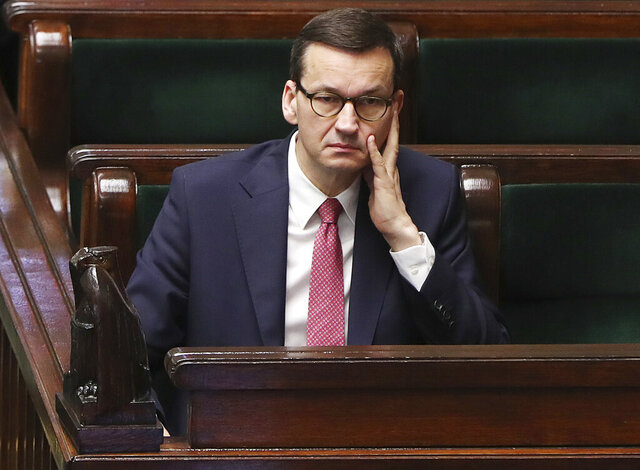 Poland's Prime Minister Mateusz Morawiecki following a vote in parliament that approved legislation for all-postal voting after Sunday presidential election was postponed due to organizational problems, in Warsaw, Poland, on Thursday, May 7, 2020. The ruling party says that July 12 is the possible new date for the election.(AP Photo/Czarek Sokolowski)