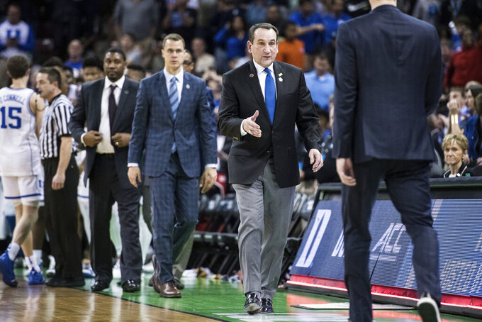 Duke coach Mike Krzyzewski prepares to shake hands with North Dakota State coach David Richman after a first-round game in the NCAA men's college basketball tournament Friday, March 22, 2019, in Columbia, S.C. Duke defeated North Dakota State 85-62. (AP Photo/Sean Rayford)